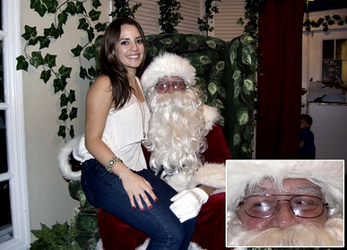 Sexy christmas elf sits on santa039s face 9